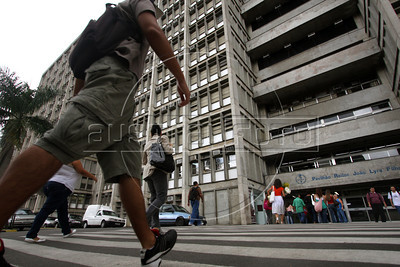 "Students and visitors enter the Rio de Janeiro State University (UERJ) main campus in Rio de Janeiro, Brazil. The UERJ was one of the first universities in Brazil to adopt admittance quotas based on race. The quota system sparked a huge debate in Brazil when first implemented, since some students which benefitted from the quotas, took the place of others who scored higher on entrance exams. The would-be student left behind claimed that the constitutional ""equal access to schooling"" was not being obeyed. (Australfoto/Douglas Engle)"