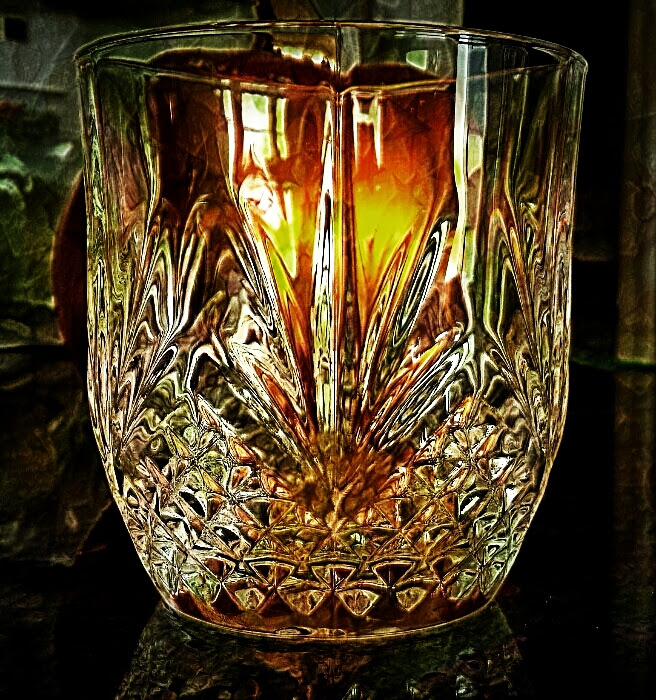 A crystal glass with a ceramic pumpkin behind it. Also used snapseed, Pixlr Express and Super Photo apps.