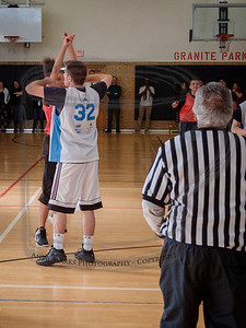 Brian trying to block a student's shot