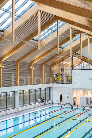 St John's School in Leatherhead have recently opened their new indoor sports facility. Designed by Faulkner Brown Architects, the main feature of the new complex is a 25m six lane, heated swimming pool with spectator seating, a first floor viewing gallery, competition timed equipment, and wet and dry changing facilities. A large new fitness gym, a dance studio and a new reception and office areas compete the complex, which has been built around the existing sports hall. Client: St John's School. Architect: Faulkner Brown. Engineer: Elliott Wood