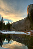 "<h3>El Capitan at Sunset with the Merced River</h3>The sun is setting over the Yosemite Valley.  The Merced River is in the foreground providing that great reflection.  The color on El Capitan is from the sun just getting ready to disappear.<br><br>I continue to play with HDR with this picture.  I took 10 exposures each 1/3 EV apart.  I then used Photomatix to combine them.  I like this approach as opposed to carrying around the various filters that would be need to balance the exposure of the sky with the valley floor.<br><br>You can find other pictures from my visit to Yosemite at <a href=""http://catchlightpictures.smugmug.com/gallery/4369278_x8uJQ/1"">Yosemite Gallery</a>"