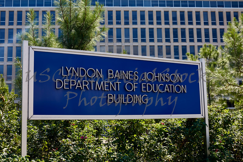 Department of Education Sign in front of Building