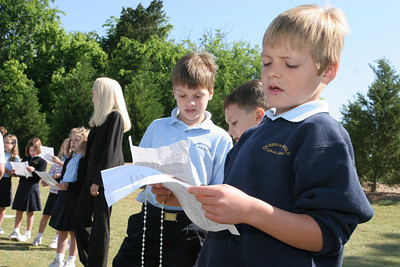 (R-l) First graders Jack Oblen and Luke Sharpton and Jack's brother Ian, a second grader, sing the closing hymn to conclude the service.