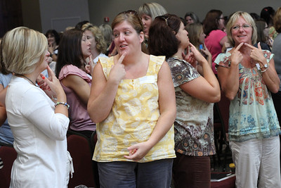 "(L-r) Lori Smith, Danielle Jenkins, Denise Bandini and Kathy Stringer of Prince of Peace of Peace Church Preschool, Flowery Branch, play the childhood game of ""I Like Me, I Like You."""