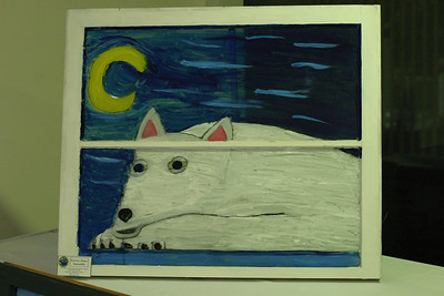 "Jordan Thomas drew this painting of a Siberian Husky. Thomas said, ""I used curved blue lines that represent the cool Arctic breeze, and I drew the moon with it to show how the animal was forced to work at night."" Thomas' inspiration for the painting was drawn from his own ten-month-old Siberian Husky named Hercules."