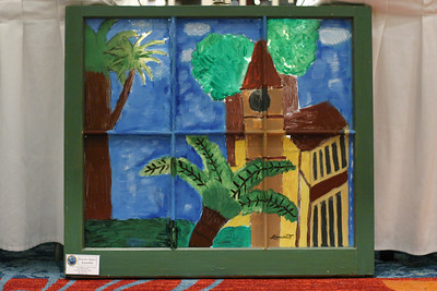 Leocadia Tchouaffe's painting of a German church in Cameroon's southern city of Kribi was one of the 31 paintings done by seventh grade artists from St. John the Evangelist School who participated in the 10th annual Window Art Exhibition at the Renaissance Concourse Atlanta Airport Hotel, March 5. All of the art is framed with old, donated window frames. The theme for this year's project, which was coordinated by the school's art teacher Angela Bush, was world travel. The students came up with the theme and they also research their subjects.