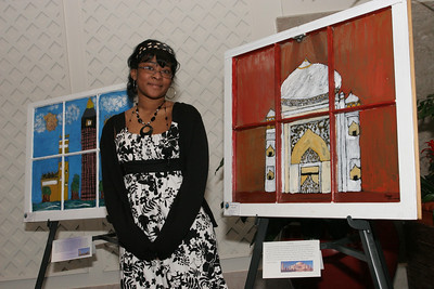 "Jordy Timmons stands beside her painting of the Taj Mahal. Timmons said, ""I chose the Taj Mahal for my window design because of its beautiful structure and design. I don't have any personal experiences with the Taj Mahal, but I do plan on going there at some point. Looking at this window, I feel as if I am there."""