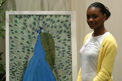 "Thirteen-year-old Brittany Gates stands by her painting of a blue peacock that is native to India. Gates said, ""The peacock possesses religious significance and national importance to India. What inspired me to paint a peacock is how unique and pretty this bird is. I also like how colorful this bird is."""