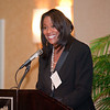 Master of ceremony Karyn Greer speaks to the audience.  Photo by Gibbs Frazeur