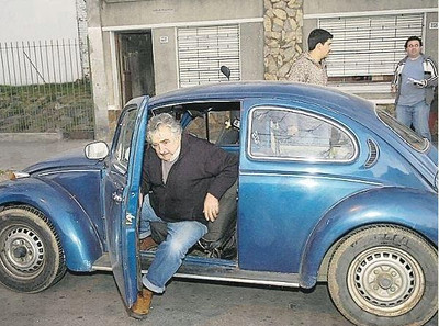 Mujica drives an '87 Volkswagen and is a part time farmer.  He grows chrysanthemums to sell at nearby markets.  He lives on his farm with his wife, who was also an imprisoned guerilla fighter and member of Tupamaros.  She is currently a Uruguayan senator.