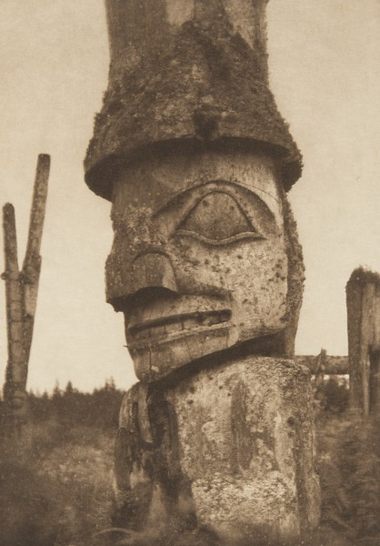 Totem at Yan, representing a Caucasian (The North American Indian, v. XI. Cambridge, MA: The University Press, 1916)