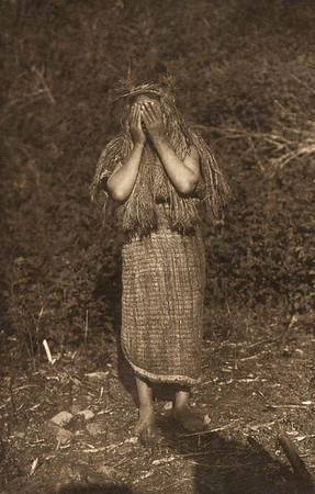 Woman Shaman looking for clairvoyant visions (The North American Indian, v. XI. Cambridge, MA: The University Press, 1916)
