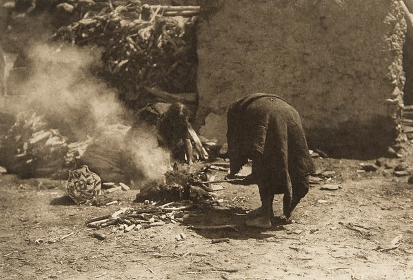 Firing pottery (The North American Indian, v. XII. Norwood, MA, The Plimpton Press, 1922)