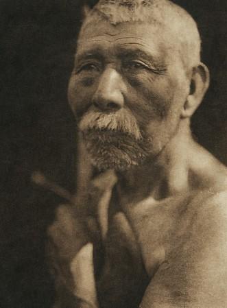 Hupa man (The North American Indian, v. XIII. Norwood, MA, The Plimpton Press,  1924)