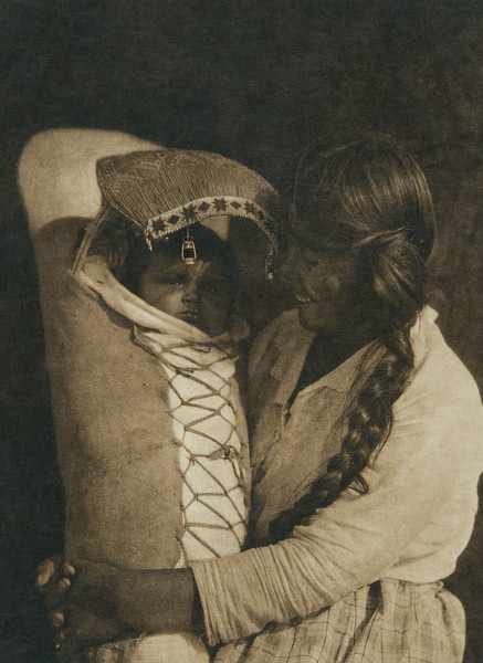 Achomawi mother and child (The North American Indian, v. XIII. Norwood, MA, The Plimpton Press,  1924)