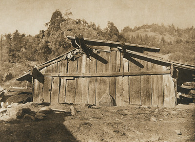 A house at Wakhtek - Yurok (The North American Indian, v. XIII. Norwood, MA, The Plimpton Press,  1924)