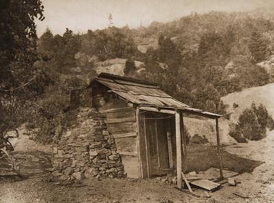 Karok house at Soames Bar  (The North American Indian, v. XIII. Norwood, MA, The Plimpton Press,  1924)