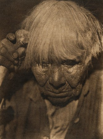 Old woman in mouring - Yuki (The North American Indian, v. XIV. Norwood, MA, The Plimpton Press, 1924)