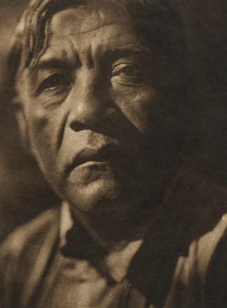 A coast Pomo man (The North American Indian, v. XIV. Norwood, MA, The Plimpton Press, 1924)