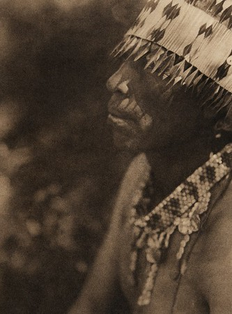 Coast Pomo with feather head-dress (The North American Indian, v. XIV. Norwood, MA, The Plimpton Press, 1924)