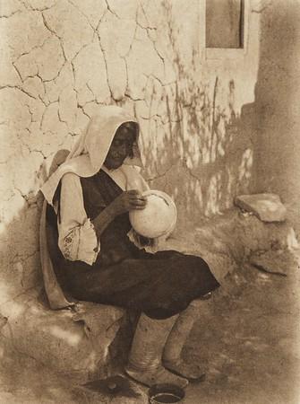An Isleta potter (The North American Indian, v. XVI. Norwood, MA, The Plimpton Press,  1926)