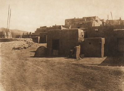 A corner of Taos and a kiva entrance (The North American Indian, v. XVI. Norwood, MA, The Plimpton Press,  1926)
