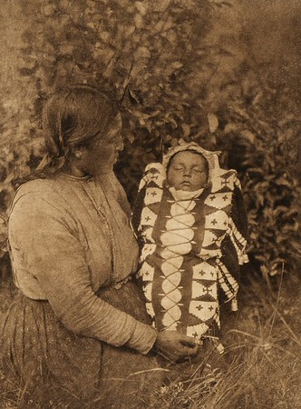 """Isqe-sis - """"Woman Small"""" - and child - Cree (The North American Indian, v. XVIII. Norwood, MA, The Plimpton Press,  1928)"""