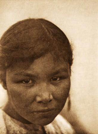 A Cree girl (The North American Indian, v. XVIII. Norwood, MA, The Plimpton Press,  1928)