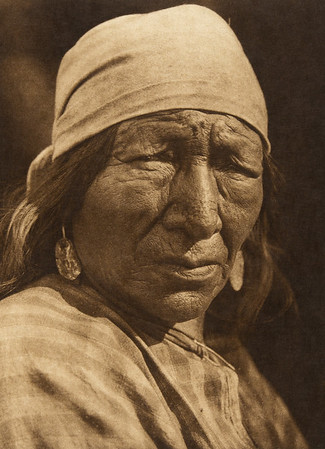 A Blackfoot woman (The North American Indian, v. XVIII. Norwood, MA, The Plimpton Press,  1928)