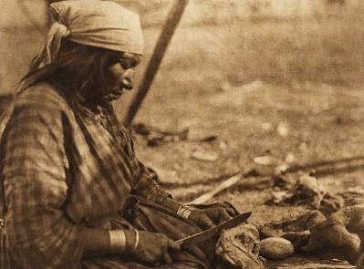 A Piegan woman (The North American Indian, v. XVIII. Norwood, MA, The Plimpton Press,  1928)