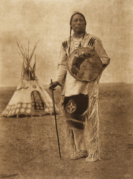 "Akatsim-atsissi - ""Whistle Smoke"" - Piegan (The North American Indian, v. XVIII. Norwood, MA, The Plimpton Press,  1928)"