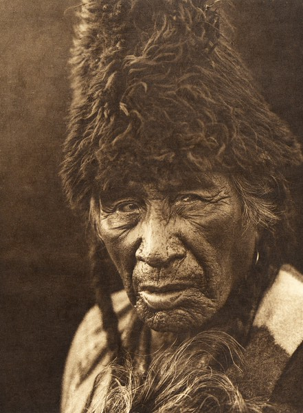 "Oksoy-Apiw - ""Raw-eater Old-man"" - Blackfoot (The North American Indian, v. XVIII. Norwood, MA, The Plimpton Press,  1928)"