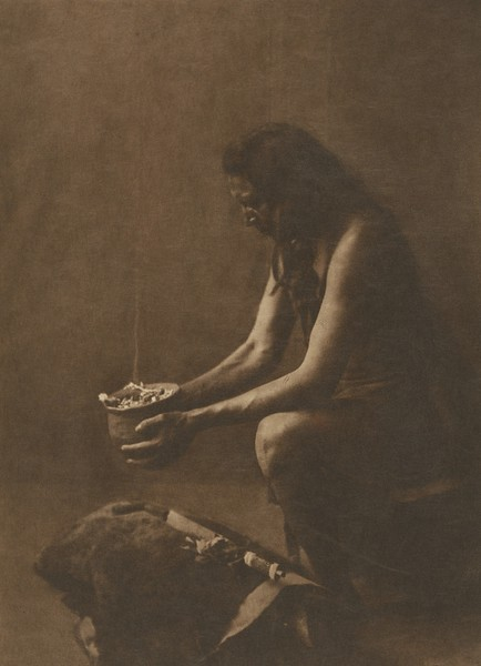 Incense Over a Medicine Bundle - Hidatsa (Indians of North America, v. IV. Cambridge, MA: The University Press, 1909)
