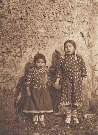 Sisters - Apsaroke (Indians of North America, v. IV. Cambridge, MA: The University Press, 1909)