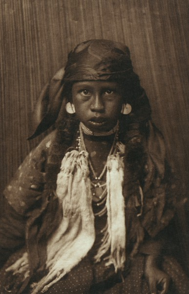 Young Kalispel Girl (The North American Indian, v. VII. Norwood, MA: The Plimpton Press, 1911)