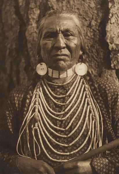 Nine Pipes - Flathead (The North American Indian, v. VII. Norwood, MA: The Plimpton Press, 1911)