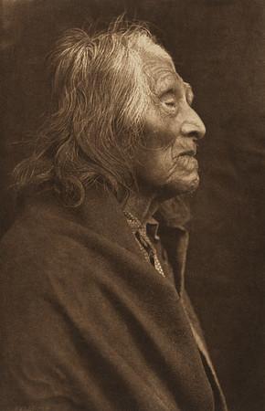 Tamlaitk - Namnit [Chinook] (The North American Indian, v. VIII. Norwood, MA: The Plimpton Press, 1911)