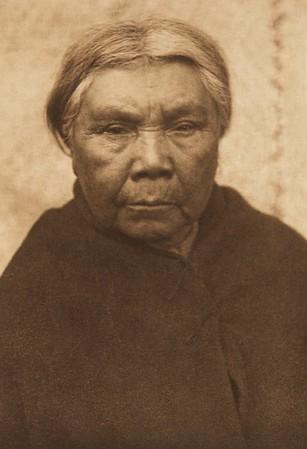 Cowichan Woman (The North American Indian, v. IX. Norwood, MA: The Plimpton Press, 1913)