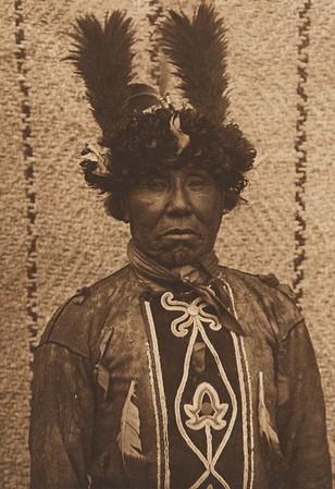Cowichan Warrior (The North American Indian, v. IX. Norwood, MA: The Plimpton Press, 1913)