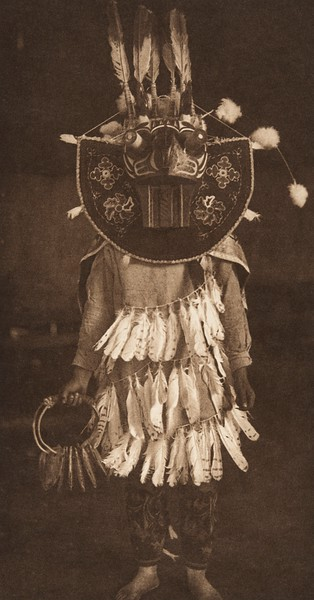 Masked Dancer - Cowichan (The North American Indian, v. IX. Norwood, MA: The Plimpton Press, 1913)