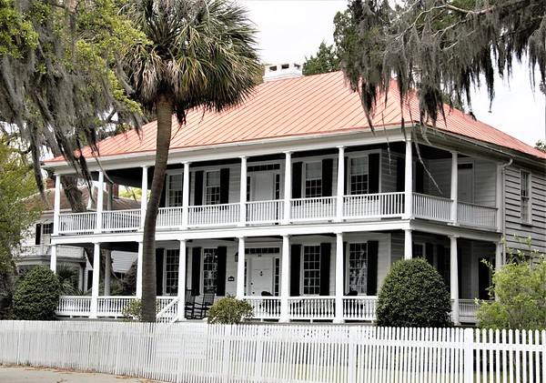 (James Robert Verdier House) Marshlands was built ca. 1814 for Dr. James Robert Verdier, who achieved prominence when he discovered a treatment for yellow fever Set high from the ground upon a tabby arcade, the two-story house gives evidence of Barbadian influence in the single story veranda that runs the length of the front and to the sides. This West Indian influence is well-blended with the more formal Adamesque features of the Republican period.