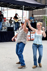 Jake Edgeworth of St. Peter, left, and Stephanie Cropper of Barn Hill, Illinois, right, dance to the music of The Experienced in downtown Effingham on Saturday afternoon during the KCBS EffingHAM-JAM sponsored by the Effingham County Chamber of Commerce. Charles Mills photo