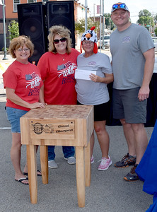 Grand Champion of the Kansas City Barbeque Society State Championship EffingHAM-JAM on Saturday were the Rooters-N-Tooters from Mt. Pleasant, Tennessee. Pictured from left, Twilla Ruholl, John Boos and Company, Connie Faught, John Boos and Company, Lynn Keltner, Rooters-N-Tooters and Paul Keltner, Rooter-N-Tooters. Charles Mills photo