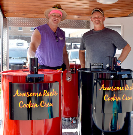 Terry Bower, left and Chad Downs, right, members of the Awesome Rack Cookin' Crew of Quincy prepare for competition on Saturday morning for the KCBS EffingHAM-JAM held in downtown Effingham over the weekend. Terry Bower is a Teutopolis native. Charles Mills photo
