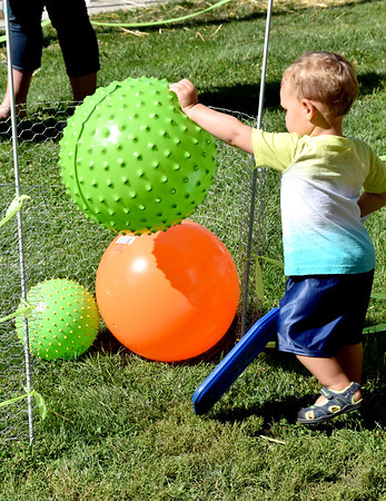 Liam Fearday navigates large plastic balls in the Equity obstacle course Saturday morning at the KCBS EffingHAM-JAM sponsored by the Effingham County Chamber of Commerce. Charles Mills photo