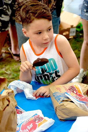 Six-year-old Elliot Tillis of Oakland, Illinois checks on the progress of one of his competitors during the Dilly Bar eating contest sponsored by the Effingham Daily Queen Saturday afternoon at the EffingHAM-JAM held in downtown Effingham. Charles Mills photo