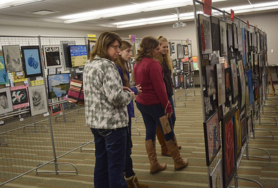 From left to right: Sharon Waldhoff, Elizabeth Waldhoff, Ashley Dust, and Amanda Waldhoff, all of Teutopolis look at art work of students at the Effingham Art Guild Children's Art Show. Dawn Schabbing photo