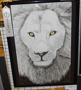 """Maria Dust, 12th grader at Effingham High School, earned third place for """"Lion"""" an ink drawing at the Effingham Art Guild Children's Art Show. Dawn Schabbing photo"""