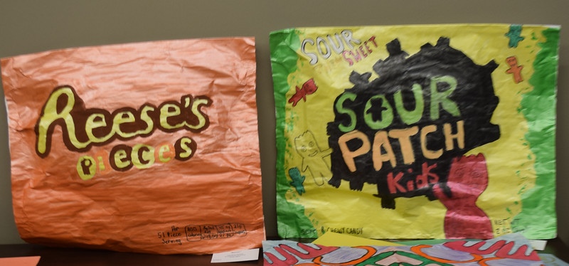 """Tempera art by Caroline Hoene, """"Reeses"""" and Evie Stullmeyer, """"Sour Patch Kids,"""" both eighth grade students at St. Anthony Grade School were among entries at the art show this week. Dawn Schabbing photo"""