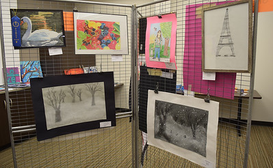 Art work from some of the youngest participants hang in one room of the Effingham library. Dawn Schabbing photo